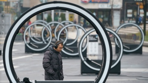 A man walks through an art installation in Montreal, on Tuesday, December 1, 2020. THE CANADIAN PRESS/Paul Chiasson