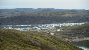 New research has found that Arctic permafrost has warmed to the point where it now releases more carbon in winter than tundra plants can absorb during the summer. The community of Apex, Nvt., is seen from Iqaluit on Friday, Aug. 2, 2019. THE CANADIAN PRESS/Sean Kilpatrick