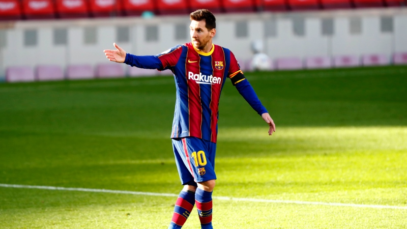 Barcelona's Lionel Messi gestures during the Spanish La Liga soccer match between FC Barcelona and Osasuna at the Camp Nou stadium in Barcelona, Spain, Sunday, Nov. 29, 2020. (AP Photo/Joan Monfort)