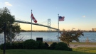 Canada and U.S. flags near the Ambassador Bridge border crossing in Windsor, Ont., on Thursday, Oct. 8, 2020. (Melanie Borrelli / CTV Windsor)