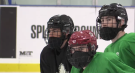 London Nationals players are now required to wear masks on the ice that attach to their helmets, as seen in London, Ont. on Tuesday, Dec. 1, 2020. (Brent Lale / CTV News)