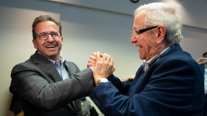 Bloc Quebecois Leader Yves-Francois Blanchet, centre, is greeted by Bloc Quebec veteran Louis Plamondon as he arrives at first party caucus, Thursday, October 24, 2019 in Quebec City. THE CANADIAN PRESS/Jacques Boissinot