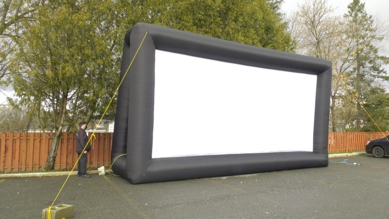 Symphony Senior Living Orléans has set up a screen in the parking lot ahead of its holiday drive-in experience this weekend.