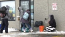 People receiving food at the door of the Gate at Access Place on Dec. 2, 2020 . (Lisa Risom/CTV Prince Albert)