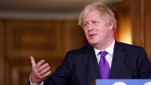 Britain's Prime Minister Boris Johnson speaks during a news conference on the ongoing situation with the coronavirus pandemic, at Downing Street in London, Wednesday Dec. 2, 2020. (John Sibley/Pool via AP)