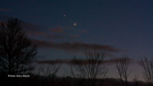 Brilliant Jupiter and Saturn (upper left) are now seen in the western sky after sunset. They are moving closer together in the sky and will be 1/5 the width of the full moon on December 21 when both can be seen in a telescope. Taken from South Mountain, Ontario on December 1. (Gary Boyle 'The Backyard Astronomer'/CTV Viewer)