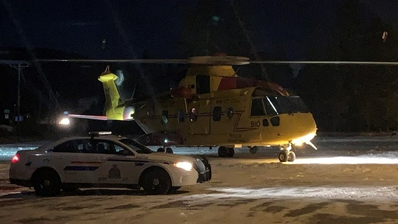 A Cormorant helicopter belonging to the Canadian Armed Forces was dispatched to help rescue a police officer and suspect who were stuck in the bottom of a ravine (Photo B.C. RCMP).