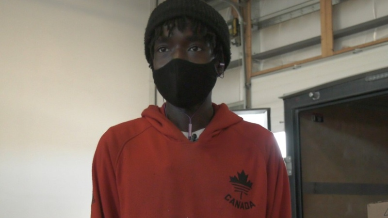 Memo Timon is working long hours to deal with rush of Christmas packages at a local delivery company. (Carla Shynkaruk/CTV Saskatoon)