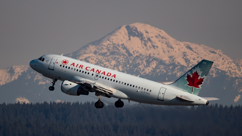 An Air Canada flight takes off at Vancouver International Airport, in Richmond, B.C., on Friday, March 20, 2020. THE CANADIAN PRESS/Darryl Dyck