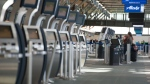 Empty lines for check in for the United States is pictured at Vancouver International Airport in Richmond, B.C. Wednesday, March 18, 2020. THE CANADIAN PRESS/Jonathan Hayward