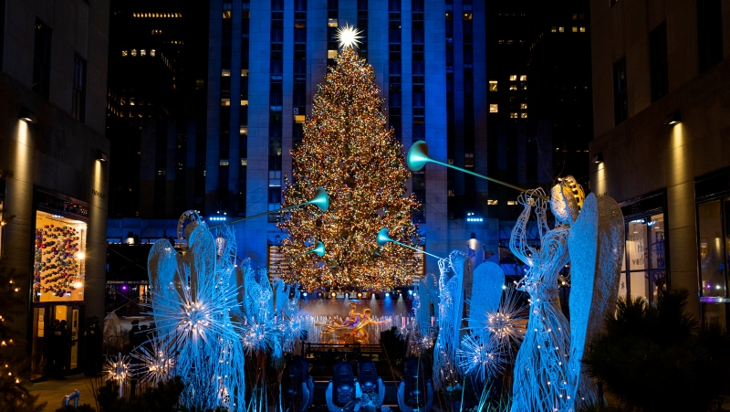 More than 50,000 lights on the 75-foot-tall Rockefeller Center Christmas Tree are illuminated at the annual Rockefeller Center Christmas Tree lighting ceremony, Wednesday, Dec. 2, 2020, in New York. (AP Photo/Craig Ruttle)