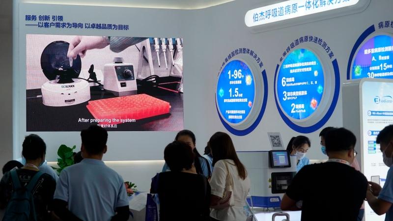 Shanghai-based testing kit company BioGerm presents a booth at a trade fair in Nanchang in eastern China's Jiangxi province on Friday, Aug. 21, 2020. (AP Photo/Dake Kang)