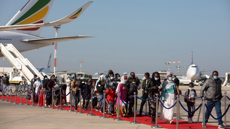 Ethiopian immigrants arrive at the Ben Gurion airport near Tel Aviv, Israel, Thursday, Dec. 3, 2020. (AP Photo/Sebastian Scheiner)