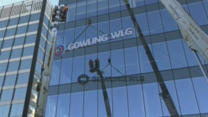 Part of King Street West was shut down as cranes hoisted up the new Gowling WLG sign.