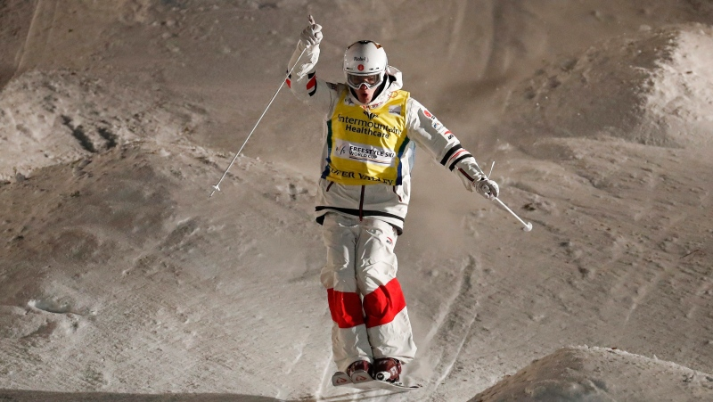 Mikael Kingsbury, of Canada, celebrates as he finishes his final run during the World Cup freestyle men's dual moguls skiing event in Park City, Utah, on February 8, 2020. Canadian freestyle skiing star Mikael Kingsbury climbed the World Cup podium for the ninth time this season on Sunday, finishing second in a dual moguls event. The 27-year-old from Deux-Montagnes, Que., finished behind Japanese rival and friend Ikuma Horishima. THE CANADIAN PRESS/AP, Jeff Swinger