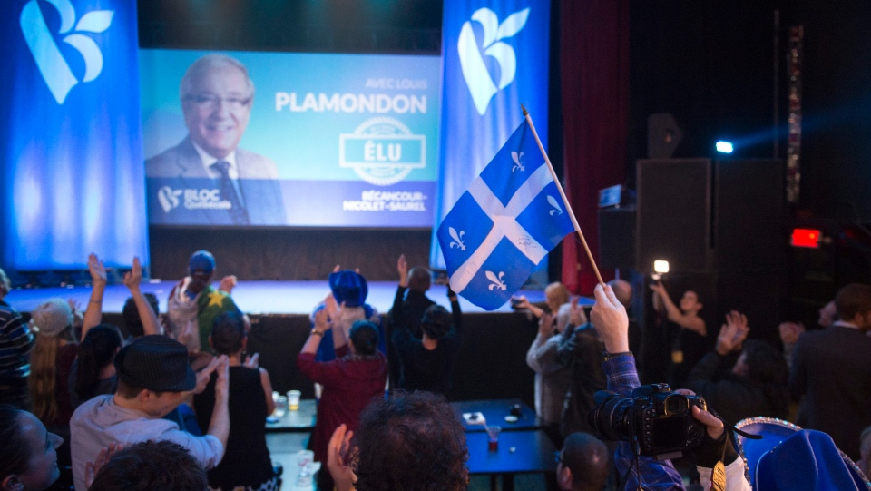 Bloc Quebecois supporters react to the election of their candidate Louis Plamondon, at their party election headquarters Monday, October 19, 2015 in Montreal Que. Canadians are voting in a general election. THE CANADIAN PRESS/Jacques Boissinot
