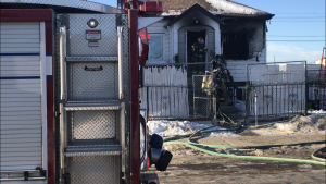 A fire broke out at a house near 105 Avenue and 98 Street on Dec. 3, 2020.