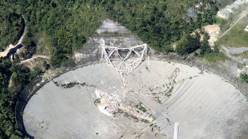 This photo provided by Aeromed shows the collapsed Radio Telescope in Arecibo, Puerto Rico, Tuesday, Dec. 1, 2020. (Yamil Rodriguez/Aeromed via AP)
