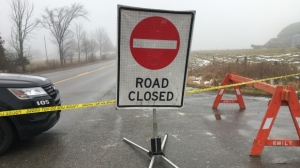 OPP closes the road in Kawartha Lakes, Ont., near Lindsay, for a police investigation.