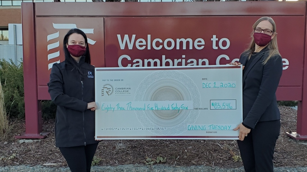 Ccambrian College officials with donations