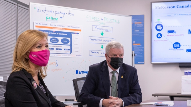 Ontario Health Minister Christine Elliott and Rick Hillier, who is overseeing the COVID-19 vaccine rollout, participate in a meeting at McKesson Canada in Toronto on Tuesday December 1, 2020. THE CANADIAN PRESS/Frank Gunn