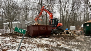 The Lepage family home was torn down in Constance Bay on Thursday, more than a year after it was damaged by spring flooding along the Ottawa River. (Dylan Dyson/CTV News Ottawa)