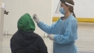 A health care worker conducts a COVID-19 test in Orillia, Ont. (Siobhan Morris/CTV News)