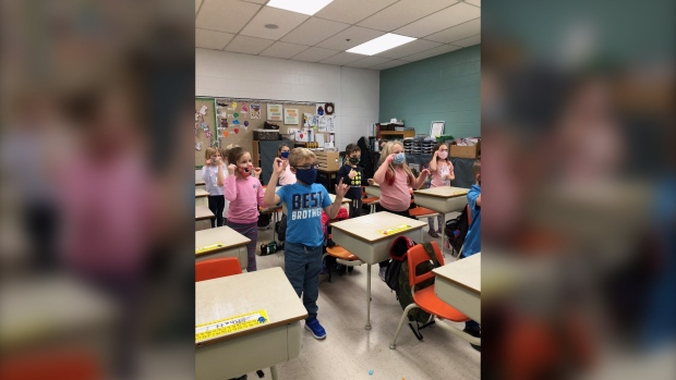 A Grade 1 class at École Vickers Public School in Prince Albert has learned how to sign O Canada as an alternative to singing during the pandemic. (Sheryl Lepine/Submitted)