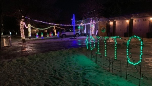 Paula Paterson's neighbour goes all out when it comes to decorating his house for the holidays, her house takes a more subtle approach. (Source: Jamie Dowsett/ CTV News Winnipeg)