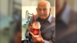 In this photo provided by Holly Wooten McDonald, Second World War veteran and COVID-19 survivor Major Wooten holds a celebratory milkshake on his 104th birthday on Thursday, Dec. 3, 2020, in Madison, Alabama. (Holly Wooten McDonald via AP)