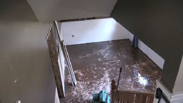 It was a muddy mess on Stewart Street where Kristina Thibault-Butland lives. Her home sustained major damage from water pouring in through her basement windows.