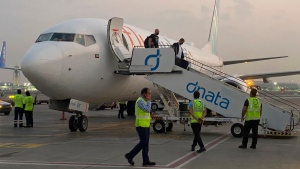 Israeli tourists leave a flydubai plane which departed from Ben-Gurion International Airport in Tel Aviv and landed in Dubai, United Arab Emirates, Sunday, Nov. 8, 2020. (AP Photo/Malak Harb, File)