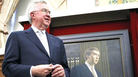 Former prime minister Joe Clark stands beside his official portrait following its unveiling on Parliament Hill in Ottawa on Tuesday May 27, 2008. (Sean Kilpatrick / THE CANADIAN PRESS)