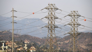 Electrical power line towers are seen in Los Angeles, California, August 19, 2020 during a triple-digit heatwave gripping the area. (Robyn Beck/AFP/Getty Images)