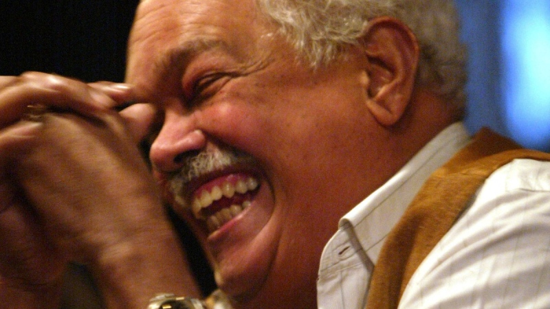 Miguel Algarin laughs during an interview in New York, on March 31, 2005. (ebeto Matthews / AP)