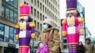 A pedestrian walks past Christmas decorations on MontrealÕs Sainte-Catherine Street, on Wednesday, December 2, 2020. THE CANADIAN PRESS/Paul Chiasson