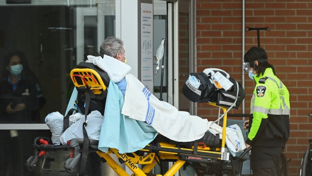 Paramedics unload a patient at an hospital emergency department in Mississauga, Ont., on Thursday, December 3, 2020. Toronto and Peel region continue to be in a COVID-19 lockdown. THE CANADIAN PRESS/Nathan Denette