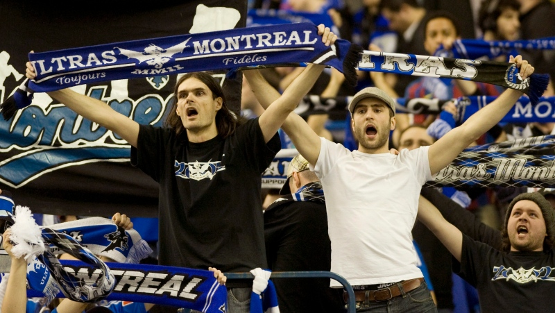 Montreal Impact fans cheer on their team following the Impact's MLS home opener soccer game against the Chicago Fire in Montreal, Saturday, March 17, 2012. THE CANADIAN PRESS/Graham Hughes