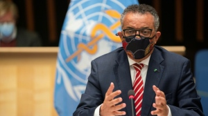World Health Organization Director-General Tedros Adhanom Ghebreyesus, seen at an event in October 2020, is warning that the poor could be 'trampled' as vaccines are rolled out for COVID-19. (AFP)