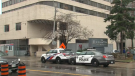 Police vehicles are pictured outside the Roehampton Hotel shelter in midtown Toronto.