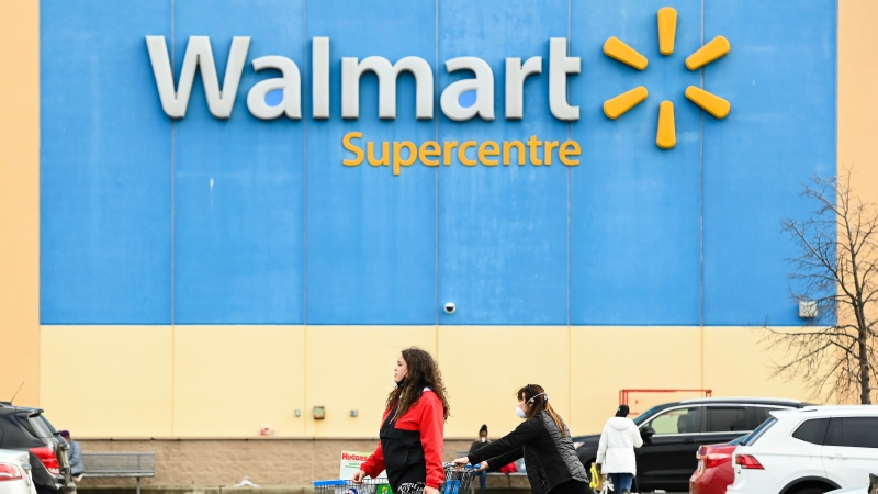 People leave the Walmart after shopping during the COVID-19 pandemic in Mississauga, Ont., Thursday, Nov. 26, 2020. THE CANADIAN PRESS/Nathan Denette
