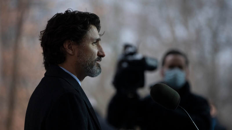 Prime Minister Justin Trudeau listens to a question during a news conference outside Rideau cottage in Ottawa, Friday December 4, 2020. THE CANADIAN PRESS/Adrian Wyld