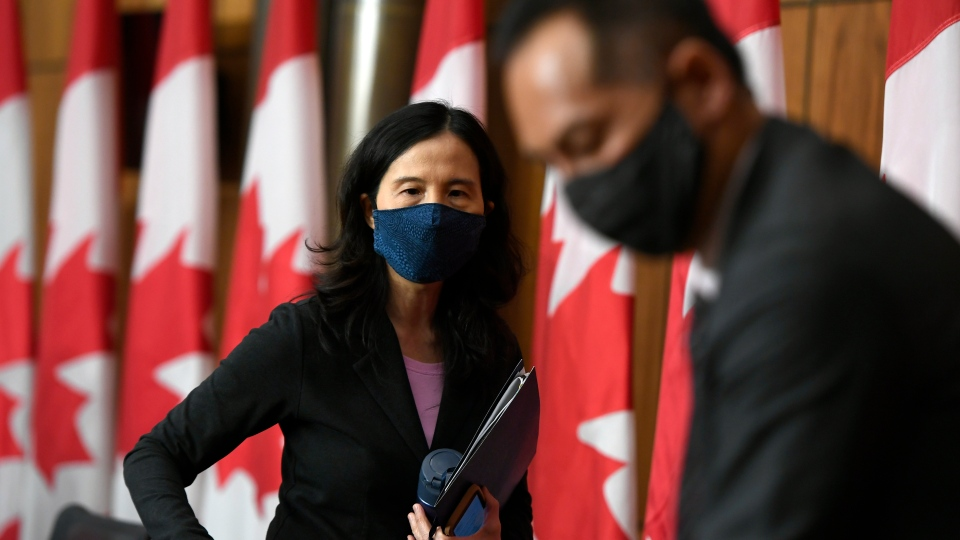 Chief Public Health Officer of Canada Dr. Theresa Tam, left, and Deputy Chief Public Health Officer Dr. Howard Njoo leave news conference on the COVID-19 pandemic in Ottawa, on Friday, Dec. 4, 2020. THE CANADIAN PRESS/Justin Tang