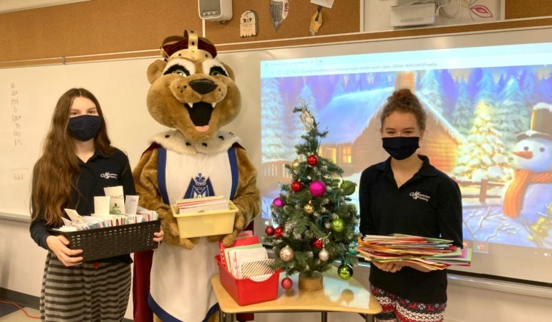 Pictured are Marymount students Stephanie St-Jean, left, and Kaitlyn Trottier. Students at Marymount Academy in Greater Sudbury are honouring Canadian Armed Forces serving overseas this Christmas by sending them 3,500 Christmas cards. (Supplied)