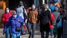 Pedestrians stroll along Spring Garden Road in Halifax on Thursday, Nov. 19, 2020. THE CANADIAN PRESS/Andrew Vaughan