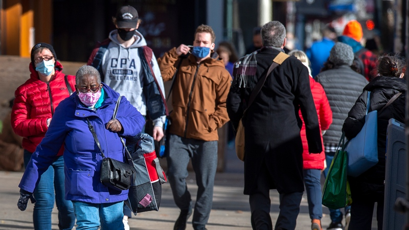 Pedestrians stroll along Spring Garden Road in Halifax on Thursday, Nov. 19, 2020. THE CANADIAN PRESS/Andrew Vaughan