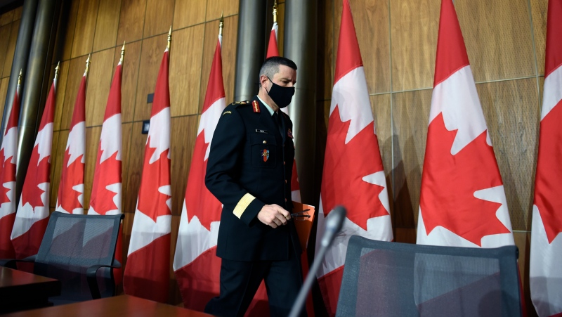 Maj.-Gen. Dany Fortin, Vice-President of Logistics and Operations at the Public Health Agency of Canada, leaves after participating in a technical briefing on the roll-out of COVID-19 vaccines, in Ottawa, on Thursday, Dec. 3, 2020. THE CANADIAN PRESS/Justin Tang