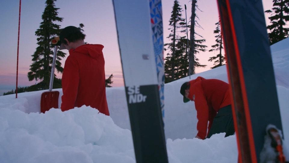 North Shore Rescue team members digging out in the snow on a local mountain. (Submitted)