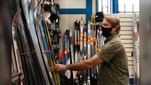 "Dean Sampson, owner of Sampson's Sporting Life, displays Nordic skis that are cordoned off inside his Pembina Highway store. He says cross-country-ski sales have been ""booming off the hook."""