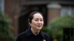 Meng Wanzhou, chief financial officer of Huawei, leaves her home to attend a hearing at B.C. Supreme Court, in Vancouver, on Friday, Nov. 27, 2020. (Darryl Dyck / THE CANADIAN PRESS)